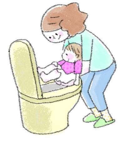 子どもを排泄させているママ